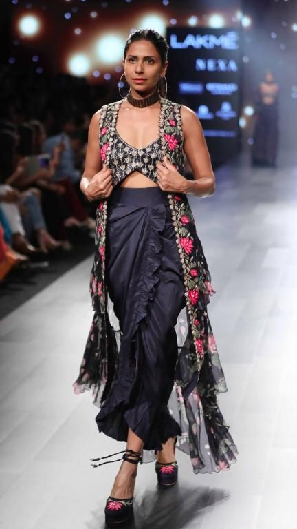 Bored of looking at pastel lehengas? Try some of these gorgeous Midnight Blue Lehengas with floral designs by Arpita Mehta.