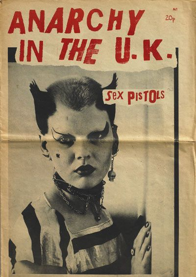Sex Pistols. 1977 was the height of punk. the punk look was all about spiked hair, mohawks, tartan trousers, leather jackets, chains, dog-collars, black nail polish etc