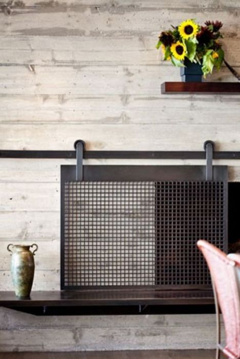 wooden fireplace screen. Beautiful sliding fireplace screen and pretty way to kid proof  The barn door trend is so fun but we d never thought of using it for a I love this fire place Kylee would look good at your