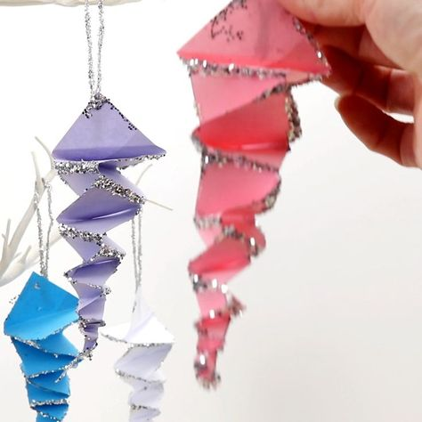 This Folded Paper Icicle Craft looks fantastic in white or colours. These homemade icicles are easy to make with the free printable pattern, just print, cut and fold! A lovely Winter craft for kids. #icicles #iciclecrafts #winter #wintercrafts #kidscrafts #papercrafts #origami #kidscraftroom #paperfolding #christmascrafts #christmasdecor #icicle #wintercraftsforkids