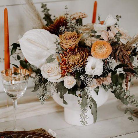 Soft white, deep greens, and bright corals make the ideal rustic wedding flower arrangemen! Head to rusticweddingchic.com for more rustic wedding flower inspiration! | #rusticwedding #rusticweddingflowers #weddingflowers | Photo: @treehavenvenue