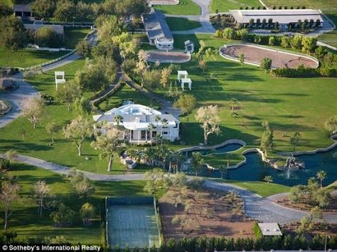 """Mr Las Vegas""Wayne Newton's compound for sale. The 40-acre mansion has a car museum, personal zoo, 'equestrian pool' and jet with its own terminal. The outrageously massive property, which is located in Las Vegas, is on sale for $48million."
