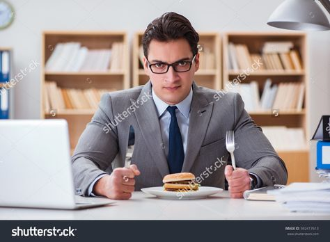 Hungry Funny Businessman Eating Junk Food Stock Photo (Edit Now) 592417613