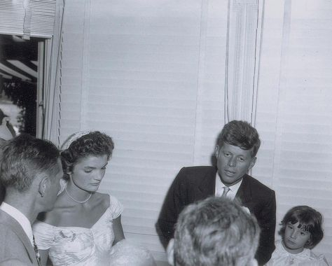 Freelance photographer Arthur Burges was hired to cover the Kennedy wedding on Sept. 12, 1953 -- he captured this candid photo of the couple on their wedding day more than 60 years ago.