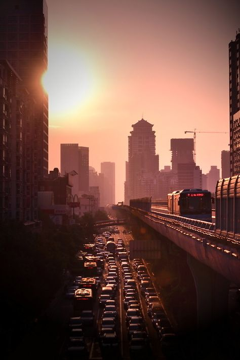 Rise and shine cars sky city sun street traffic buildings hazy jam