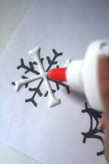 Glue Snowflakes. Lay wax paper over snowflake template. Draw lines with glue. Sprinkle w/glitter. Dry overnight. Add string to hang.