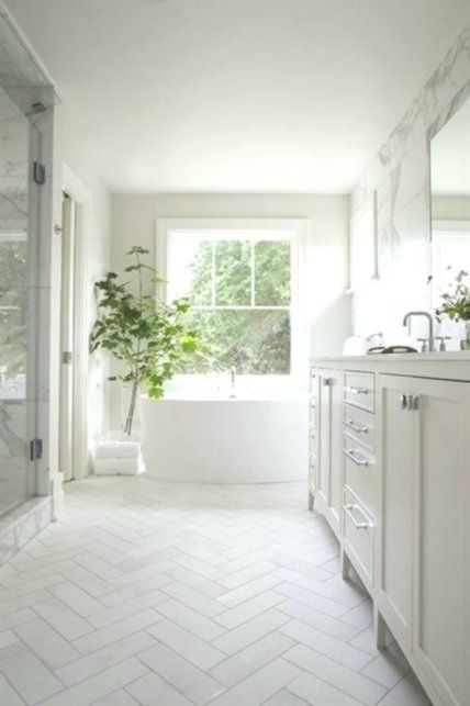 Welcoming White Bathroom Is Fitted With Honed White Marble Herringbone Floor Til Bathroom Fitte White Marble Bathrooms White Bathroom Glamorous Bathroom