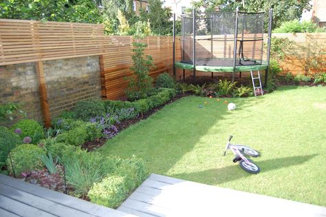 Shelley Hugh-Jones Garden Design: Trampoline position integrated into the planting. Low buxus hedging, buxus balls mixed with ferns, heucheras and less structured perennials