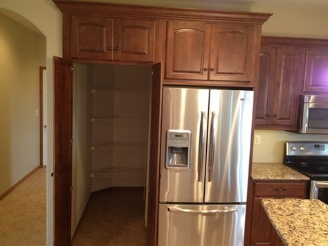 Walk-in pantry that looks built-in!  Ahh nuts!!  What didn't I see this a year ago?