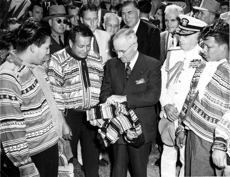 President Truman was presented with a Seminole shirt by a group of Seminole Indians and dignitaries looking on. December 6, 1947  People pictured: Leahy, William D. (William Daniel), 1875-1959; Osceola, William McKinley; Truman, Harry S., 1884-1972