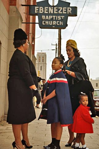 Coretta Scott King and her daughters, Yolanda and Bernice, speak with a parishioner outside Ebenezer Baptist Church in Atlanta
