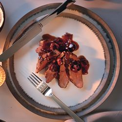 Romantic Dinner Menu from Epicurious    Duck Breast with Cherries, Rapini, Smoked Salmon with Dilled Cream, and Peach Royale to drink