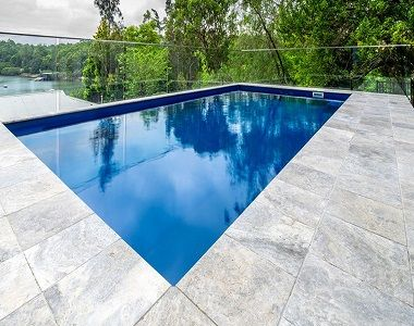 Silver Travertine Tiles Tumbled And Unfilled At Stone Pavers Australia Travertine Pool Pool Pavers Travertine Pool Coping