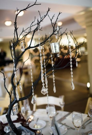 Tabletop tree decor. I like the little silver buckets.