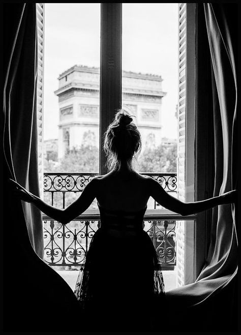 A black and white picture of a young woman looking out onto the Arc de Triomphe in Paris. All you can do is wonder what hotel this is and where you can book a room with such a stunning view. This poster looks great in combination with other dark images or in combination with our floral posters.
