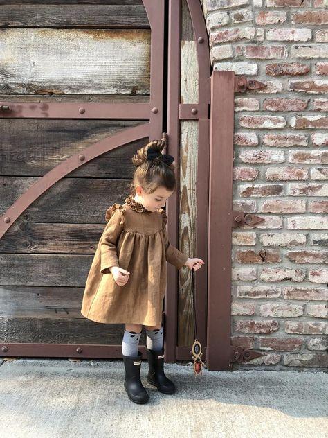 linen - ruffle collar detail - shoulder ruffles - long sleeve - wood buttons on back Girls Fall Dresses, Girls Fall Outfits, Dresses For Tweens, Little Girl Outfits, Little Girl Fashion, Baby Girl Dresses, Baby Dress, Toddler Girl Style, Toddler Girl Outfits