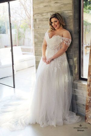 10 Statement Wedding Dresses You Never Knew You Loved Ruffled In 2020 Cheap Bridal Dresses Online Wedding Dress Plus Wedding Dresses