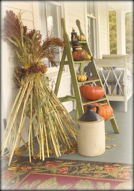 wooden ladder for pumpkin and gourd display, old jug, gathered grasses