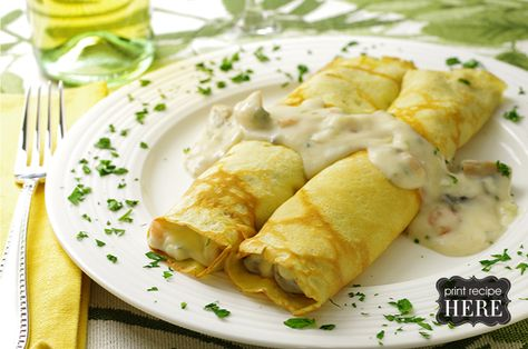 Crepes St. Jacques  Makes about 8 filled crepes  Reminiscent of the dish first experienced at the Magic Pan restaurants in the 1970s, these crepes are filled with a seafood and mushroom mixture and a béchamel sauce featuring Gruyère cheese. They make a delightful entrée.