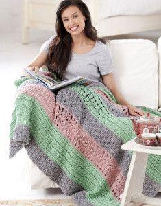 The best crochet lace pattern for spring is here! Crochet stripes in pretty pastels alternate between crochet basket weave, shell stitch, and popcorn stitch patterns. | AllFreeCrochetAfghanPatterns.com
