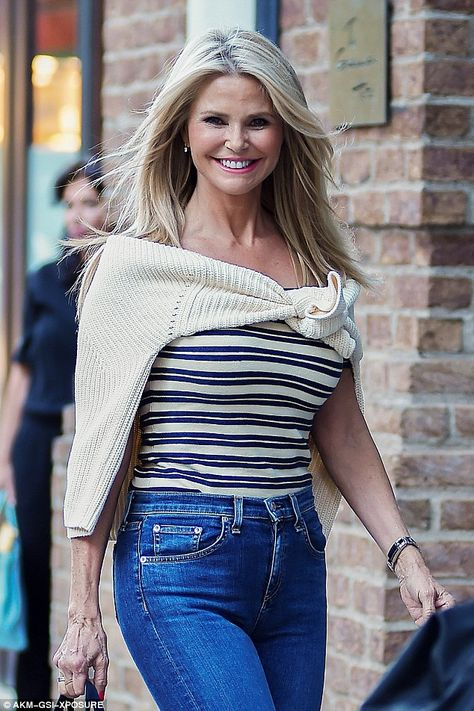Earning her fashion stripes: The Sports Illustrated pin-up dressed to complement her svelte silhouette in a fitted bardot strop emblazoned with a lemon and blue striped motif Christie Brinkley at 62. Look at her hands. she can't hide the age there. Good Plastic surgeon!