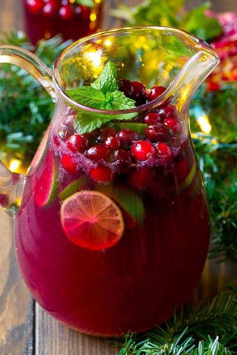 Christmas Punch is a blend of pomegranate, lime and cranberry, all mixed together into a fizzy beverage that's perfect for any holiday party.