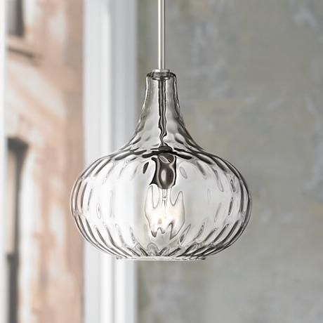 A textured glass shade is paired with a sleek brushed nickel finish, giving this mini pendant light plenty of style.