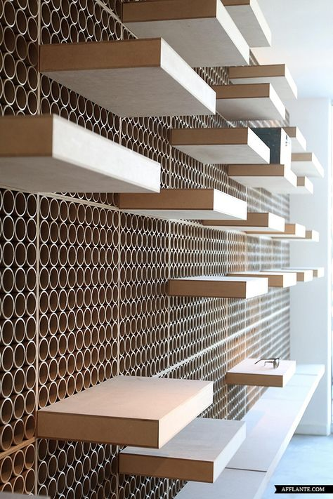 MDF with recycled cardboard tubes cut edge and a movable shelving system giving the possibility of multiple configurations.   Dr York – DCPP Architects