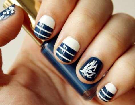 Stretch your sea legs with navy and white lines and sails.