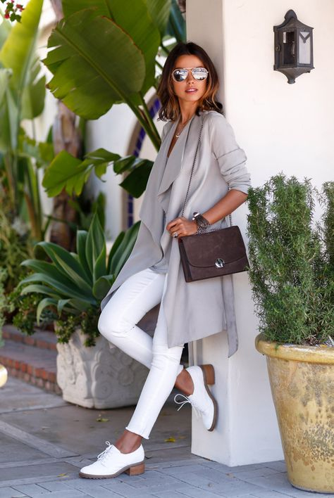 gray coat with white pants and oxfords
