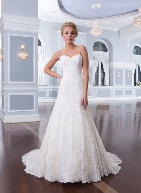 Lillian West style 6293 The re-embroidered Alencon lace sweetheart neckline flows into a drop waistline that isfollowed by an A-line skirt. Tulle buttons cover the back zipper and continue to the edgeof the chapel length train.