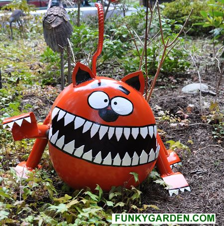 The Scary Kitty garden Sculpture is made from a recycled propane tank from earth friendly materials. He'll brighten up your garden or yard a...