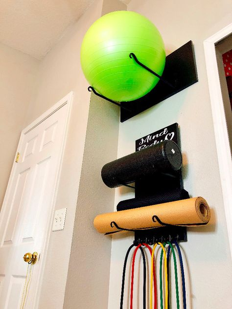 Workout Equipment Storage diy exercise ball storage + diy yoga mat storageStorage device Storage device may refer to: Diy Home Gym, Gym Room At Home, Home Gym Decor, Best Home Gym, Home Yoga Room, Garage Gym, Basement Gym, Diy Yoga Mat, Yoga Mats