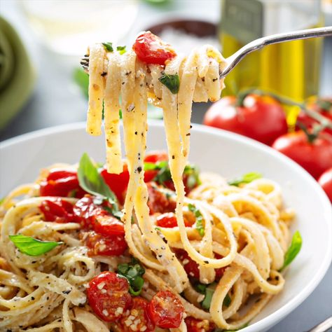 Creamy Pasta with Roasted Cherry Tomatoes: Mueller's Fettuccine Pasta is tossed in a homemade creamy goat cheese sauce and topped with garlic roasted cherry tomatoes and fresh basil! Mueller's Fettuccine Pasta is non-GMO, minimally processed and made with simple, real ingredients like wheat and water. #ad #pasta #recipe #vegetarian #dinner #goatcheese #goatcheesepasta