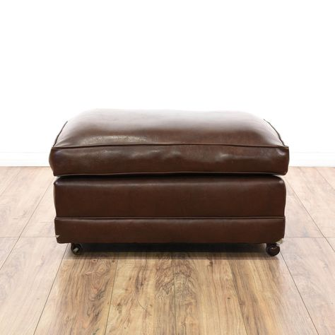 timeless design ee207 7ee3d This rolling ottoman is upholstered in a durable leather ...