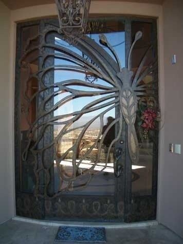 Glass Butterfly Door.  Gorgeous!