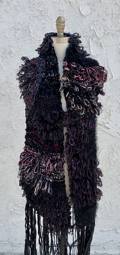 Oversized scarf crafted in a combination of chunky knit and looped stitches.Couple of pretty and cool scarves can change an entire fall/winter outfit. Our statement scarves with flowy fringe edges and chunky looped stitches wraps beautifully around any coat or jacket! Must have! Heads Will turn!Length:65 inchWidth:12 inch Dry Clean OnlyMade in USAMaterials: metallic, cashmere, merino wool ,alpaca