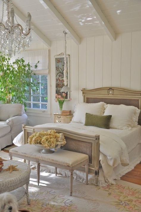 Things that inspire | white paneled walls beamed ceiling chandelier  light. French country master bedroom, light palette white panelled walls