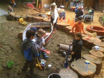 let the children play: Ideas for adding natural elements to your outdoor play space - Part 1 stumps around the sand pit.
