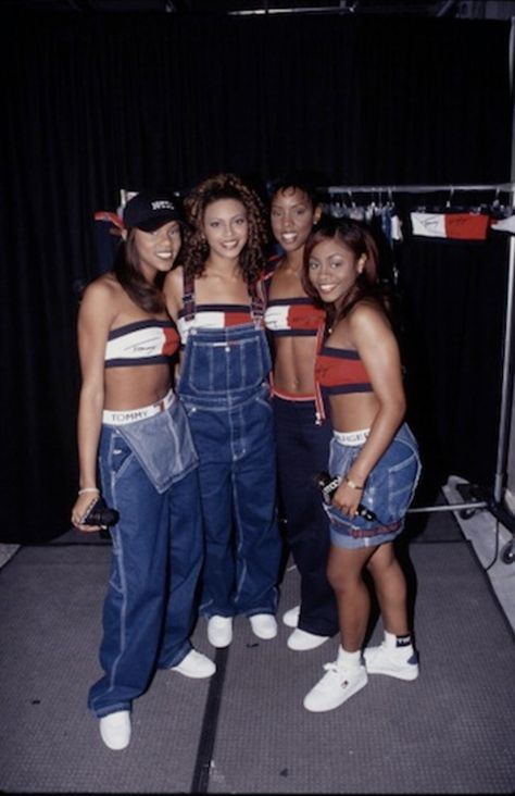 Circa March 1999Destiny Child totally knew how to rock the big luxury labels. Um, HELLO! Tommy Hilfiger! .