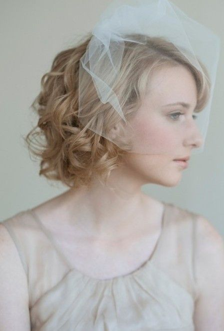 beautiful bride with short wedding hairstyle
