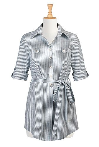 A sash tie belt nips in the waist of our woven stripe cotton shirt shaped with a center back pleat and carefully placed darts at the bodice.
