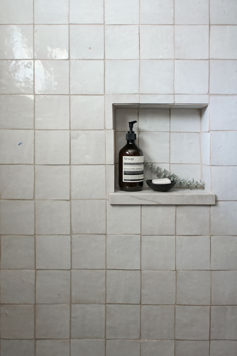 weathered white zellige tiles in shower niche