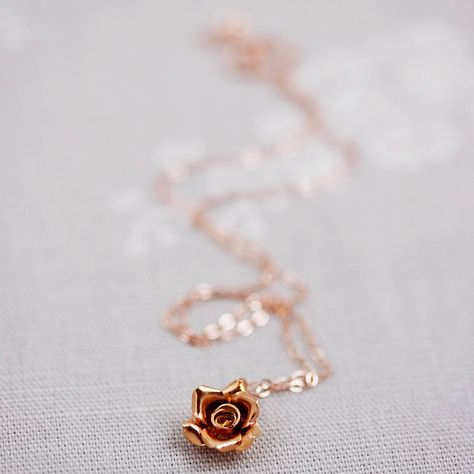 Rose Gold Wild Rose Necklace. A sweet rose gold charm in the shape of a wild rose, hung on a delicate chain.