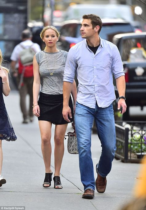 Jennifer Lawrence puts on a leggy display as she enjoys a stroll with her very hunky bodyguard in New York