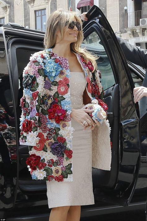 EVGENIA GL AMAZING COAT Melania showed off her chic sense of style in a statement floral jacket, which featured colorful embellishments, and came complete with a matching clutch bag
