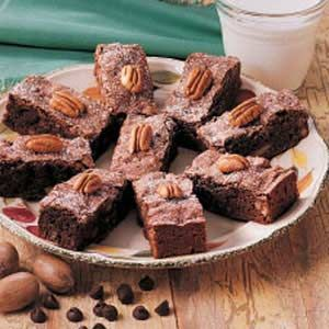 Moist Cake Brownies Recipe -These brownies have been in my recipe collection since I was 9 years old. I've added to and altered the recipe over the years, and now I think it has the perfect amount of everything, including semisweet and milk chocolate chips and pecans. They are my husband's and son's favorite. -Louise Stacey, Dane, Wisconsin