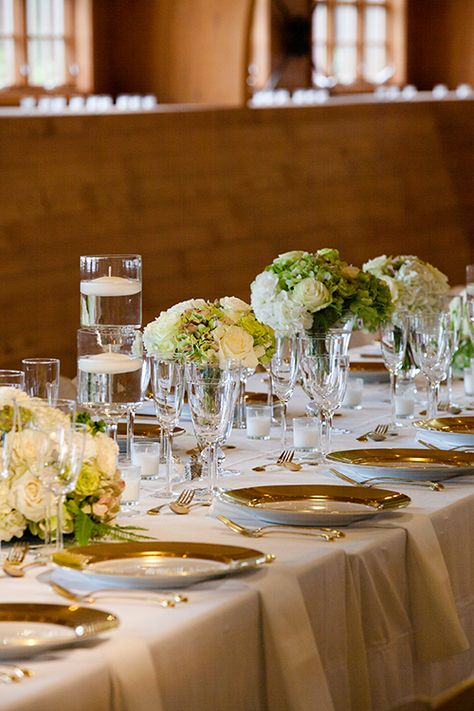 Place settings with gold chargers and flatware | @mackme | Brides.com