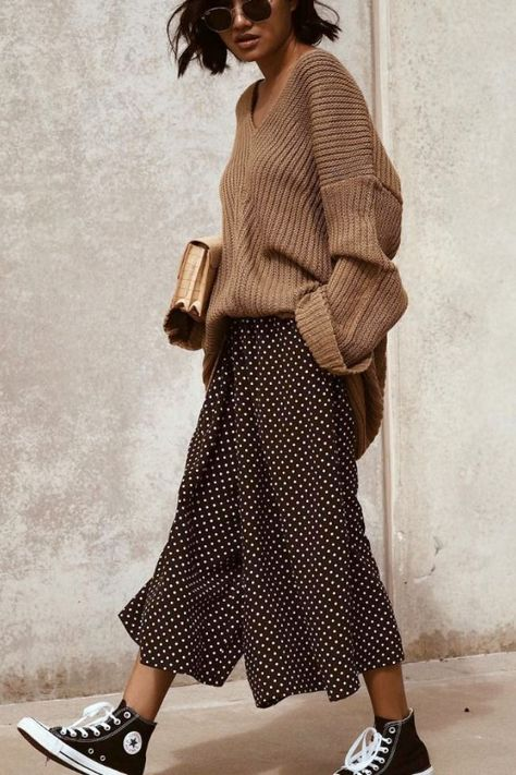 Converse sneakers with oversized neutral sweater and dotted culottes