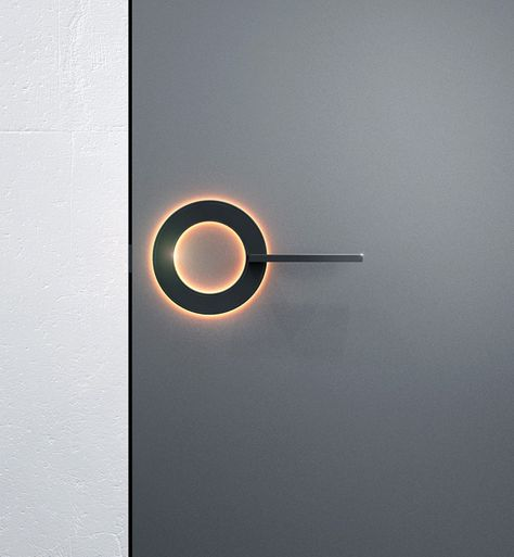 Enlightened Door:~    The very stylish ORB Door Handle can be used in diverse scenarios thanks to the integrated LED light ring. For a bathroom door handle, a lit-up ring can indicate the room is busy. For a hotel room door it can signify DND and for the children's room it can be the nightlight! ~ Designer: Michael Samoriz for Umbra-design